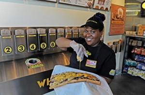 Brittany Edwards shows off a sandwich at Chich Wich. - SCOTT ELMQUIST