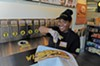 Brittany Edwards shows off a sandwich at Chich Wich.