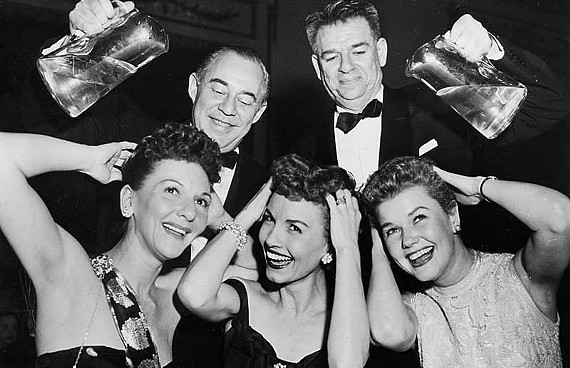 "Broadway legends Richard Rodgers and Oscar Hammerstein II help actresses Mary Martin, Janet Blair and Martha Wright wash the men right out of their hair at the 1954 closing night party for ""South Pacific."" The photo is included in a new VCU exhibit on Jewish performers."