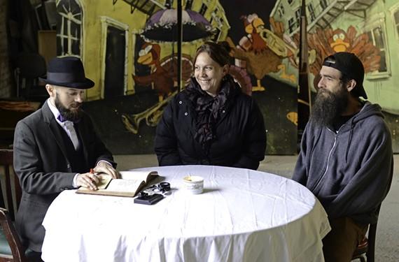 Brooklyn performance artist Cupid Ojala issues a love prescription to artist Heide Trepanier and her husband, wizard Wayne Snyder, at an event Saturday.