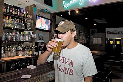 """Buddy's regular Kirk Hunter sips on a Blue Moon in Style's 2010 Bar Guide. """"I always come here,"""" he says, when asked what brings him to Buddy's. """"Because all my friends are here, and everyone knows me here."""""""