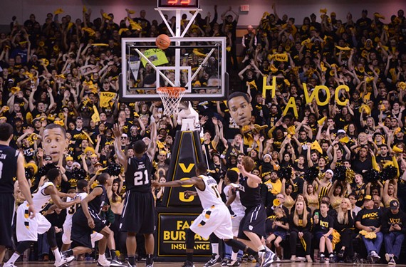 Butler's Roosevelt Jones shoots a free throw as the VCU student section, a key component of the Siegel Center's raucous environment, attempts to distract. - SCOTT ELMQUIST