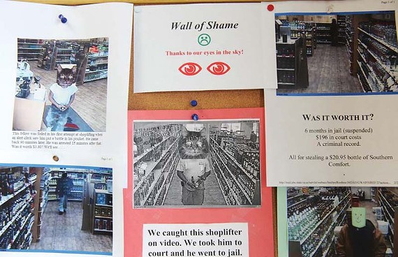 Cat faces conceal the identities of shoplifters caught in the act at the Parham One Shopping Center liquor store. - SCOTT ELMQUIST