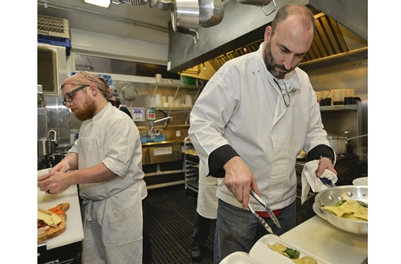 Chef Kevin LaCivita opened the second version of his Pomegranate restaurant in Carytown last week to strong response. Here he's in the kitchen with Jonathan Wheelock at left.