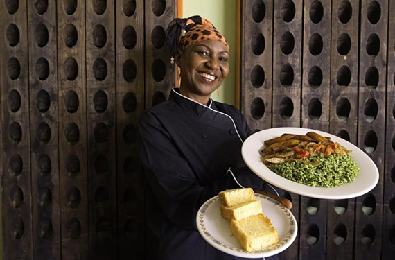 Chef MaMusu's corn bread accompanies spinach and rice with spicy stewed chicken and fried plantains.