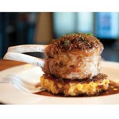 Chef Neil Smith trades life on the road catering to rock stars for a gig at LuLu's in Shockoe Bottom. His grilled double-cut pork chop is caveman-worthy. Photo by Scott Elmquist