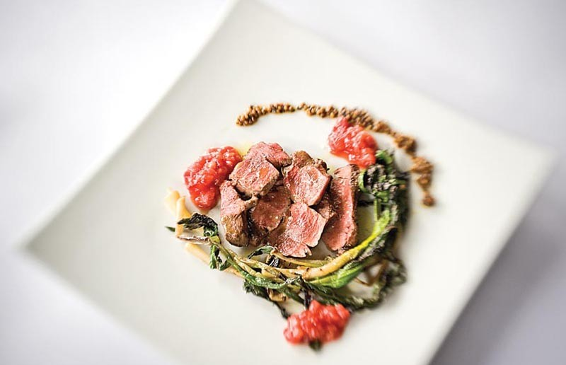 Chef Philip Denny's grilled rare beef heart with ramps, strawberry mostarda and a spice compote is an occasional special at Six Burner Restaurant in the Fan, where offal finds its way onto an increasingly adventurous menu. - ASH DANIEL/FILE