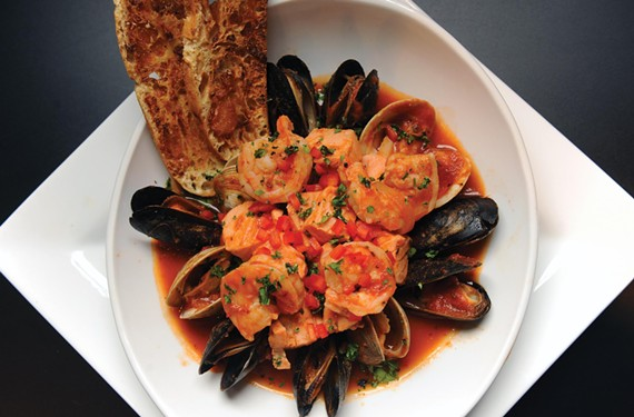 Chesapeake cioppino at Kitchen on Cary has plump shrimp, clams, mussels and rockfish in a garlic-laden tomato broth that's just right for sopping with the garlic crostini.