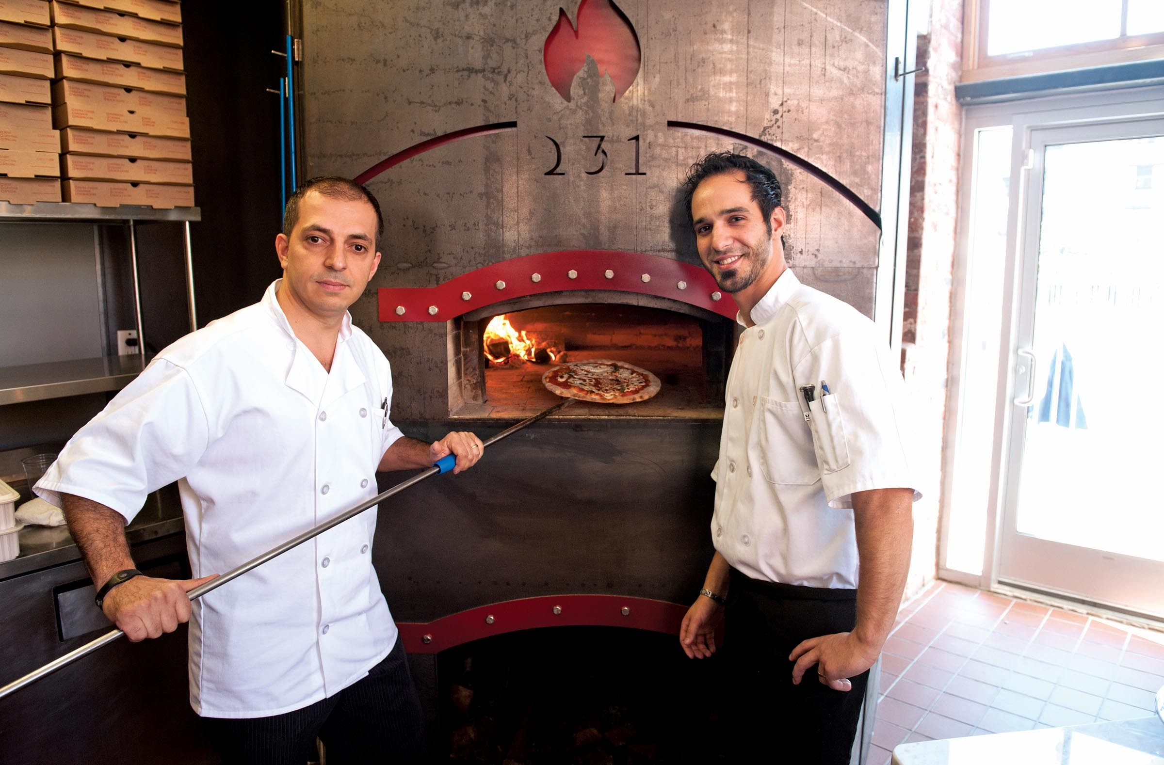 Chief Executive Danny Taormina and Chief Operating Officer Guiseppe Taormina turn up the heat at Flames 231. - SCOTT ELMQUIST