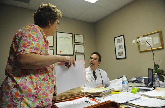 Chief nurse Carolyn Rice, a 46-year medical veteran, keeps Dr. Gergoudis' crammed day on track. - SCOTT ELMQUIST