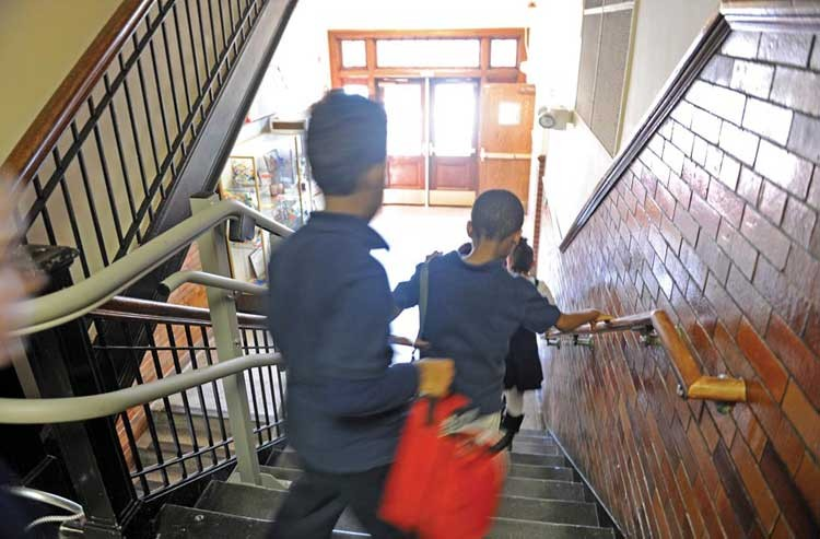 Children head downstairs to art class to learn, among other things, about Chinese New Year. It's just one example of the school's integrated curriculum, which pulls a variety of subjects across different fields of study. - SCOTT ELMQUIST