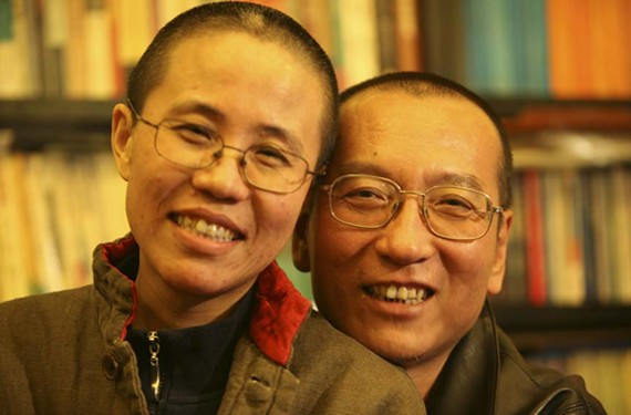 Chinese artist Liu Xia (left) poses with her husband, imprisoned Nobel Peace Prize winner Liu Xiaobo, in happier times.