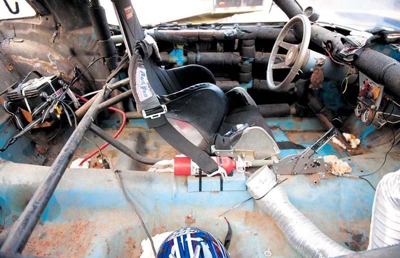 Chris Kantzler, 55, puts little money into the patchwork car which he races purely for kicks. - SCOTT ELMQUIST