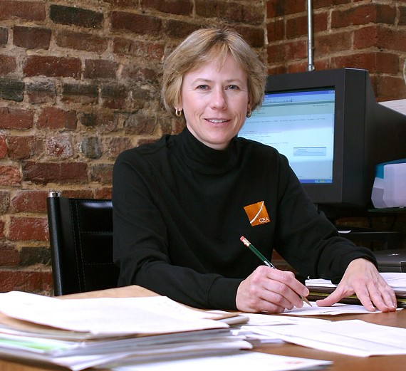 Christine Chmura works from her Shockoe Slip offices. This photo is one of several images that Chmura makes available for news and press releases on her website. - CHMURA ECONOMICS & ANALYTICS