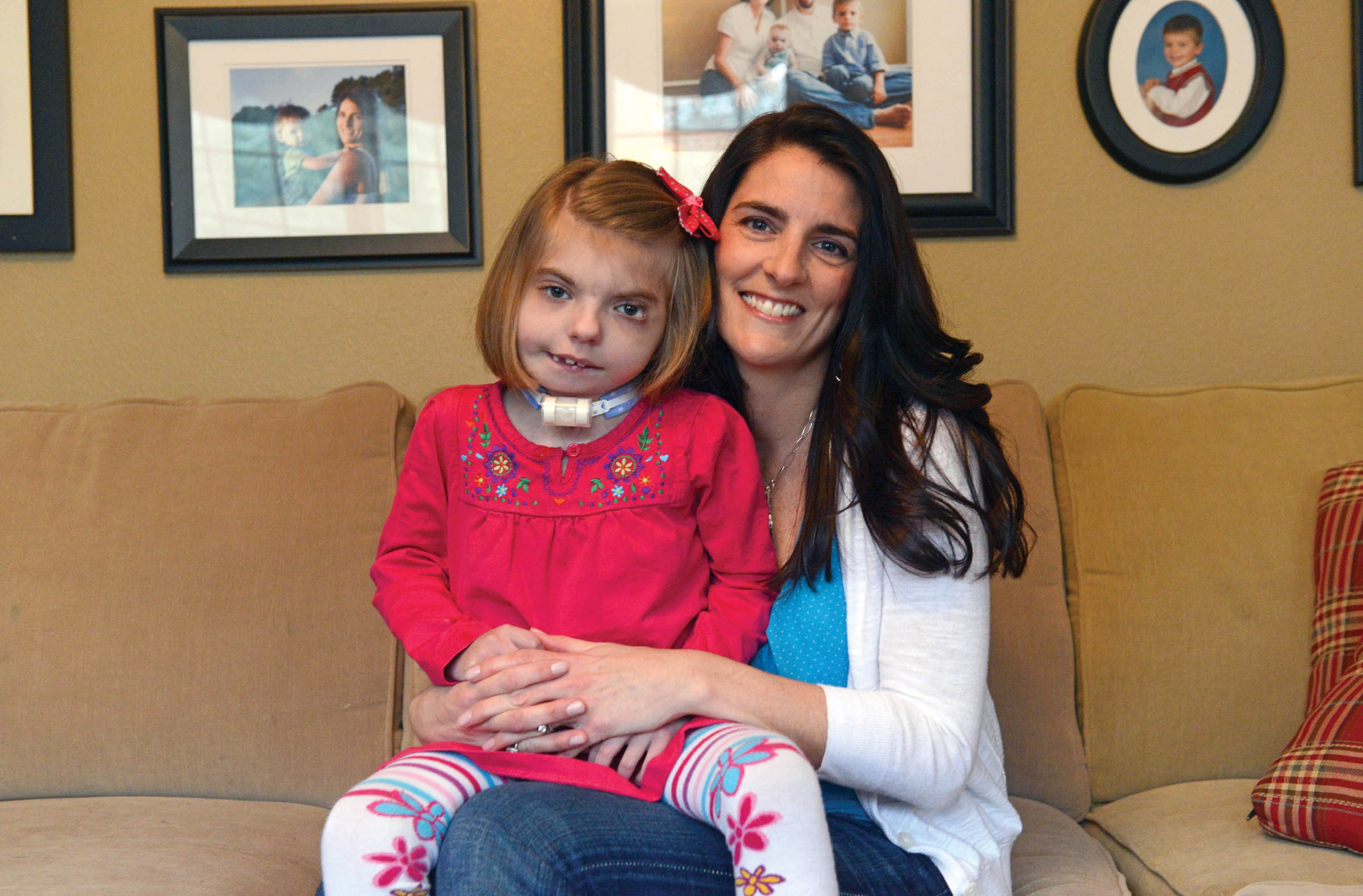 Christy Holton often must take her daughter, Harlie, who suffers from cranio-facial syndrome, heart defects and other serious ailments, out of Richmond to get the care she needs. - SCOTT ELMQUIST