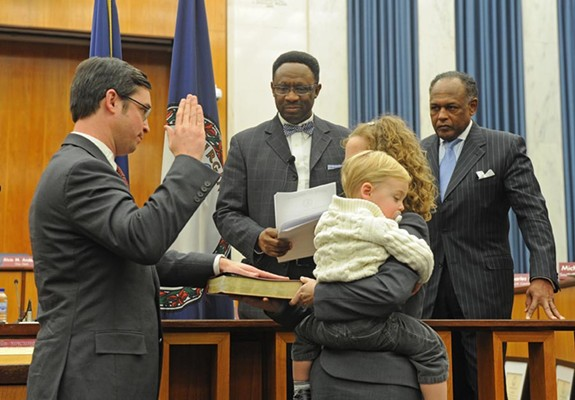 City Council President Charles Samuels is sworn in last January as Mayor Dwight Jones looks on. Jones needs seven votes to get his ballpark plan passed. - SCOTT ELMQUIST