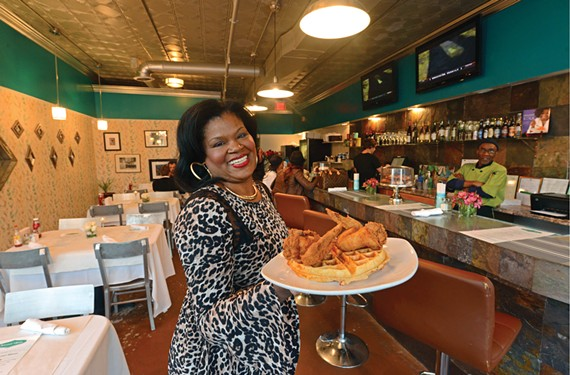 Co-owner Shane Thomas shows why customers feel at home at Sweet Teas, where the chicken and waffle is a top-selling dish.