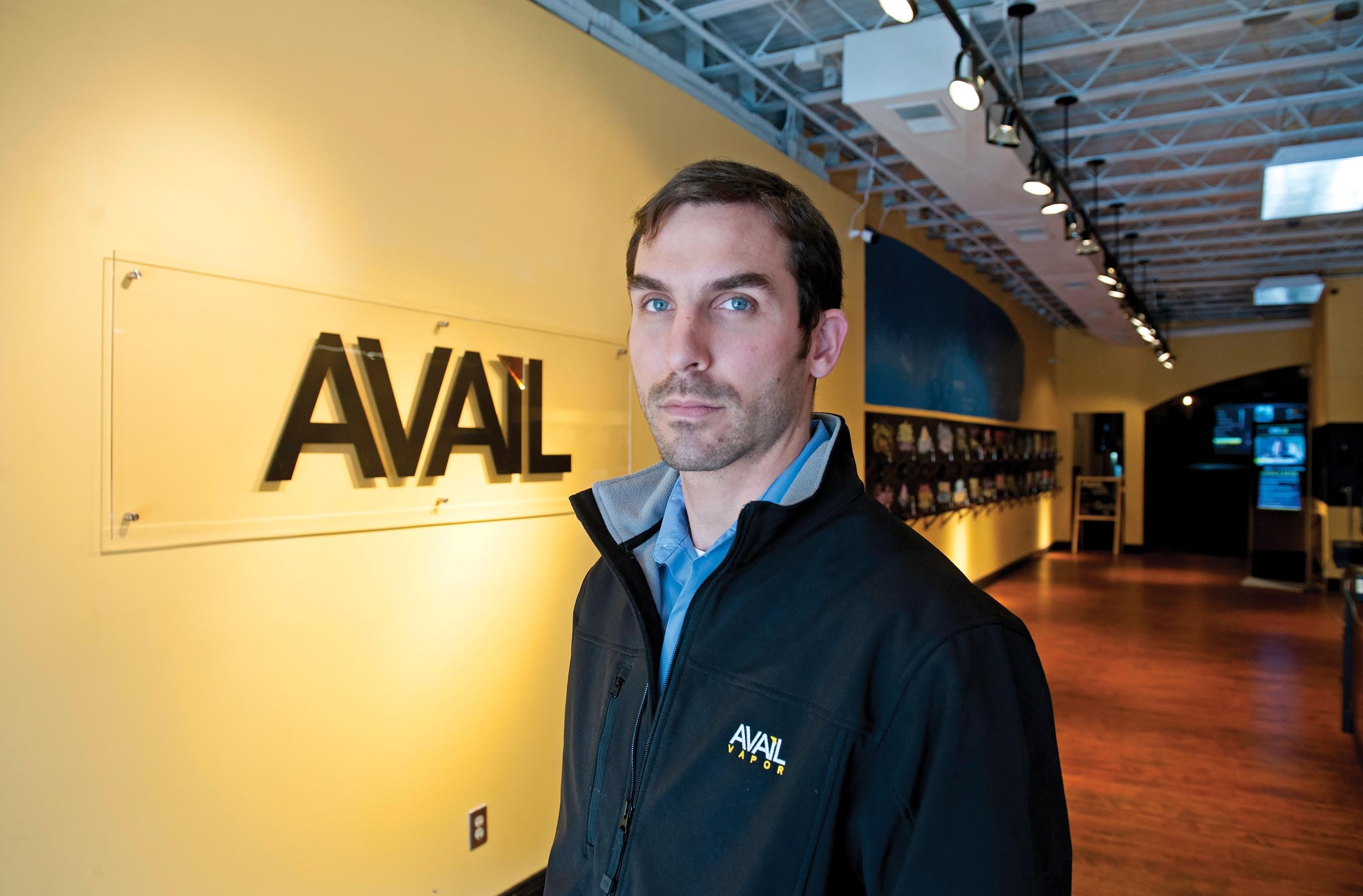 Cole Smith is co-founder of Avail Vapor in Carytown. The store, which opened last summer, makes its own nicotine juice at a factory in Henrico County. - SCOTT ELMQUIST