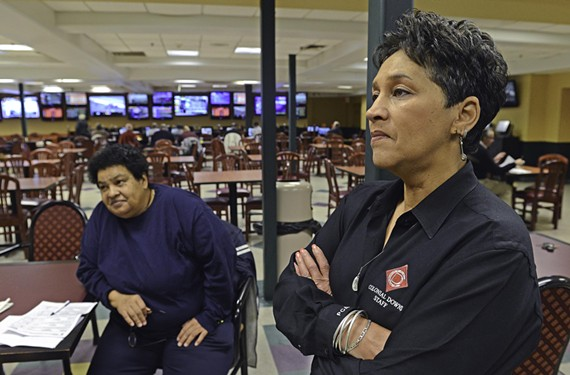 Colonial Downs' Richmond manager, Paulette Coleman, right, watches results with longtime patron Robin Boulware.