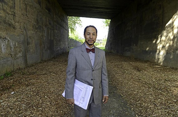 Composer Ashby Anderson stands near the African Burial Grounds in Shockoe Bottom, where his commissioned orchestral work about it was recently performed.