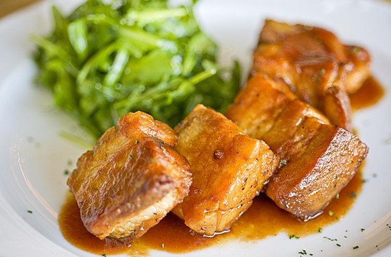 Crisp pork belly in brown ale barbecue sauce is a starter at the Savory Grain; the draft house features comfort foods from chef Sean Murphy and a range of brews and spirits. - ASH DANIEL