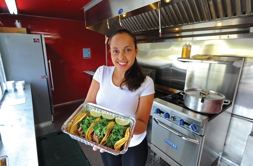 Cristina Kaiser serves carnitas tacos and other meaty specialties from her food cart in Midlothian. - SCOTT ELMQUIST