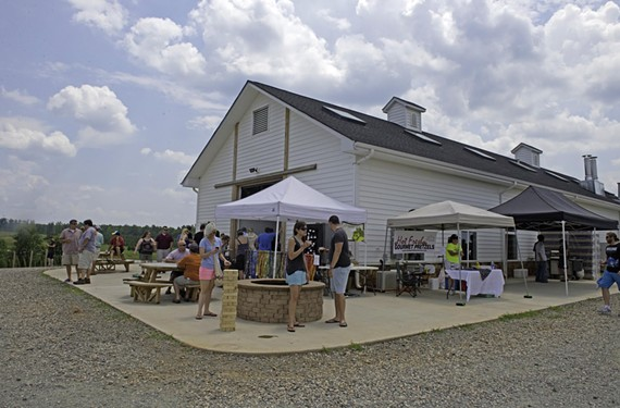 Crowds gather July 12 at Lickinghole Creek Craft Brewery in Goochland to taste the Batchelors Delight rum barrel aged Belgian-style quadrupel ale. The event, dubbed the Pirate Party, drew hundreds of people.