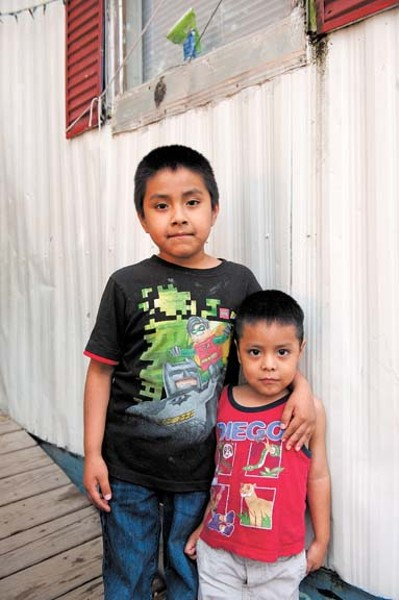 Damien Ariles and Jose Adair Arila, who live with other Mixtecos off Jefferson Davis Highway, hang out on a Sunday. - SCOTT ELMQUIST