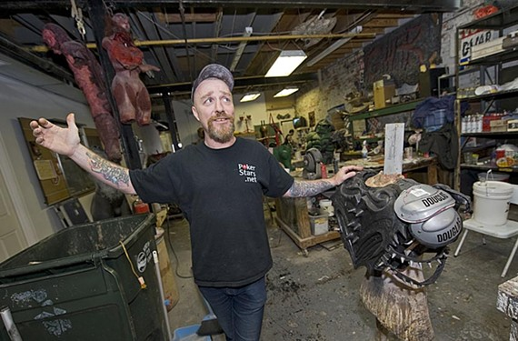 Dave Brockie, lead singer and mouthpiece, holds court during a tour of Gwar headquarters, otherwise known as the Slave Pit.