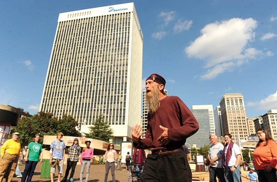 Day 9 of Occupy Richmond's protest at Kanawha Plaza downtown begins with a spirit circle led by local activist Farid Alan Schintzius. - SCOTT ELMQUIST