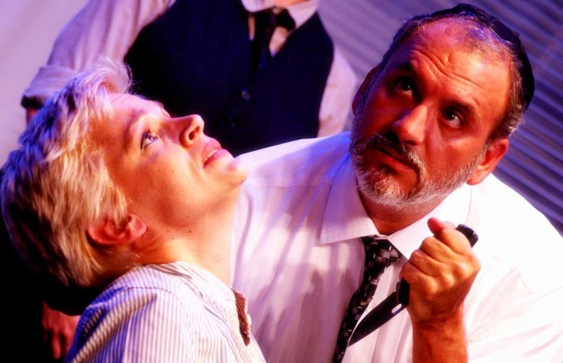 """Death on the installment plan: Antonia (Kim Jones Clark) is seriously reconsidering the contract she signed with Shylock (Jeff Clevenger) in this intense scene from Henley Street's production of """"The Merchant of Venice."""" - VINNIE GONZALEZ"""