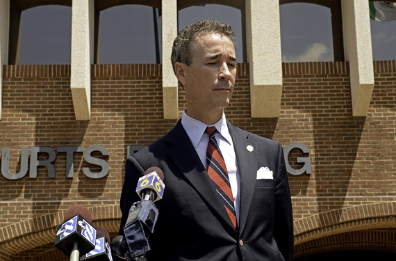 Delegate Joe Morrissey, outside the Henrico County Courthouse last week, says he's innocent and has evidence that his cell phone was hacked.