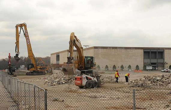 Demolition crews are at work at Cloverleaf Mall, where the former Tire America building has been flattened to accommodate a new, 123,000-square-foot Kroger. - SCOTT ELMQUIST