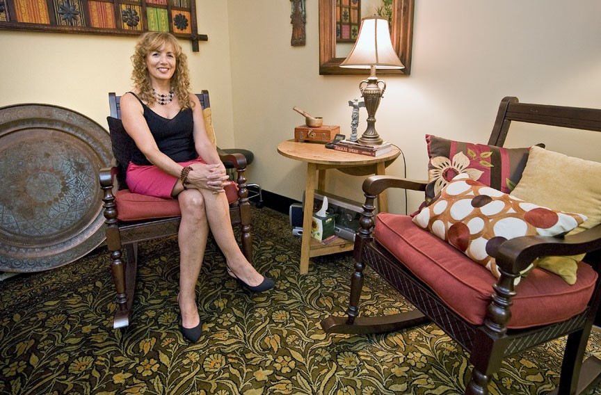 Denise Dolan brings her health and wellness training to a new position at Ellwood Thompson's; she's shown in the store's meditation and therapy room. - ASH DANIEL