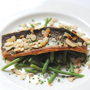 Dinner for one at Bistro Bobette's bar can be unexpectedly convivial. Here, trout sautAced in almond caper butter is served with green beans.