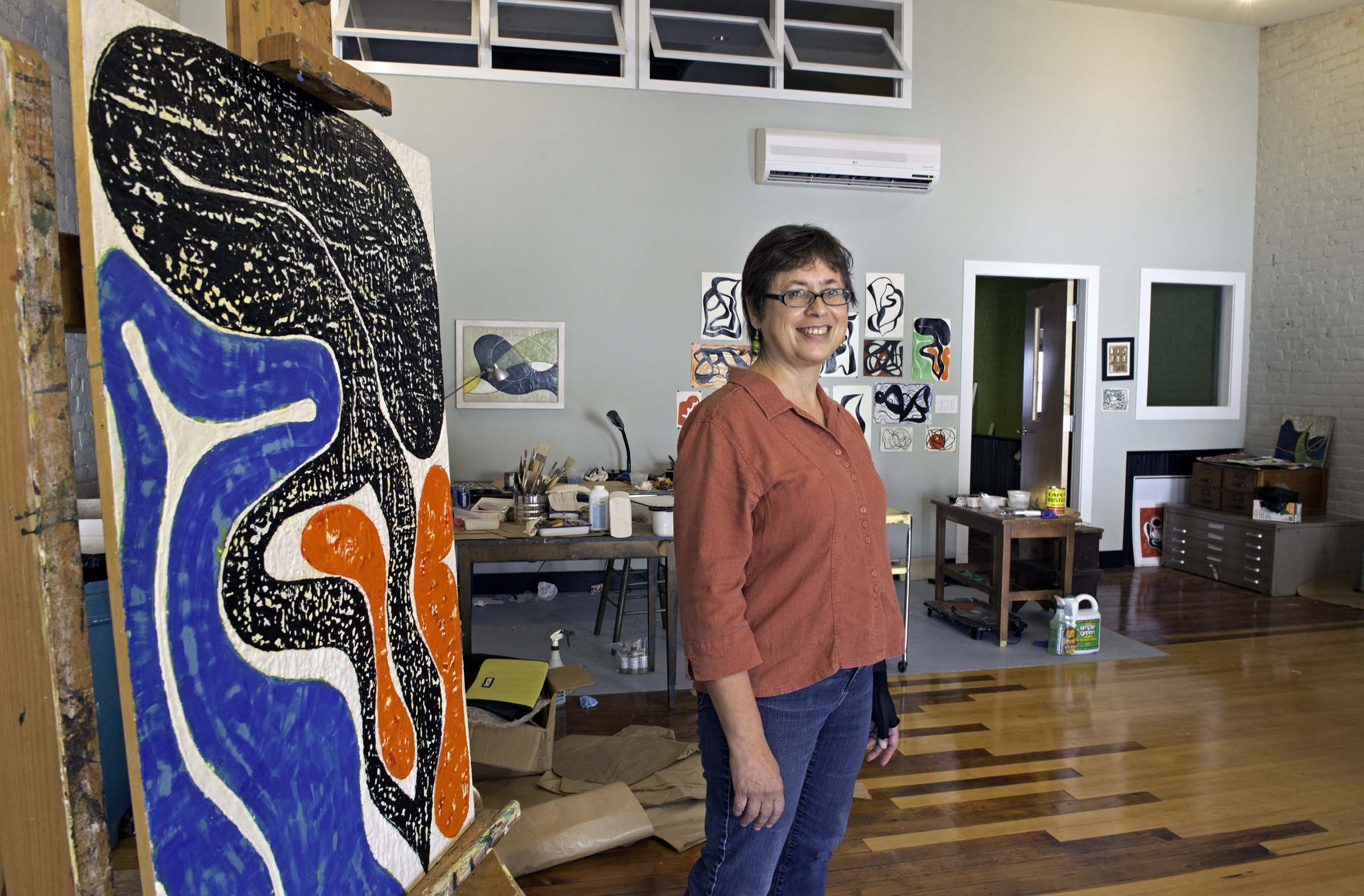Dolly Holmes and husband Mark Pehanich have built studios downtown for their painting and sculpting. - SCOTT ELMQUIST