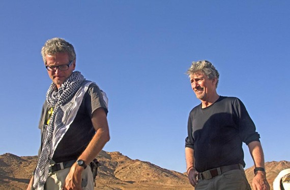 """Don Belt, right, joined Paul Salopek in traversing the deserts of southern Jordan. The veteran journalists walked north from Aqaba to Guweira, some 80 miles, by way of Wadi Rum, a beautiful remote area where scenes from the 1962 movie """"Lawrence of Arabia"""" were filmed."""