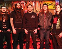 Doom metal band Howl and vocalist Vincent Hausman (center) are now available as a big sloppy burger at Chicago restaurant Kuma's Corner — next time you're in the Windy City.
