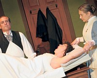 Dr. Givings (Larry Cook) prepares to treat a patient (Laine Satterfield) for hysteria as Annie the nurse (Lauren Leinhaas-Cook) looks on. The Victorian-era vibrator used on set was found in a Petersburg antique shop for $15.