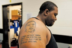 Dwayne Delaney, an Amelia County native, started playing football in the seventh grade to win his father's attention. After he was murdered in 2003, Delaney had his image tattooed on his arm, a permanent memorial. - SCOTT ELMQUIST