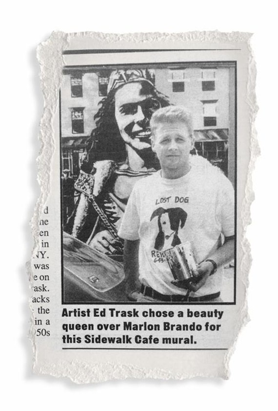 Ed Trask, who bears striking resemblance to James Dean holding a can of paint, stands in front of the now iconic mural at Main and Rowland streets.