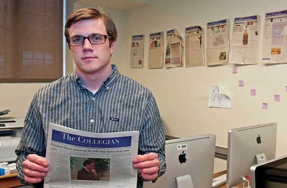 "Editor in Chief Clay Helms holds the last print edition of The Collegian, which turns 100 this year. ""We're going to re-establish our name on campus,"" he says of the newspaper's transition to an online-only publication."