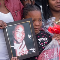 Scenes From the Vigil for Kiarri Edwards Edwards' 7-year-old-daughter Keyari holds her dad's photograph. Scott Elmquist