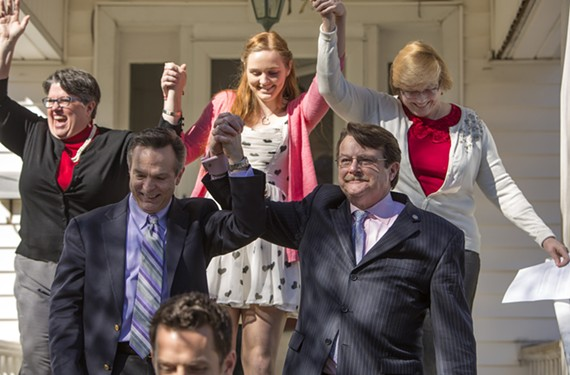 Emily Schall-Townley, 16, lifts her mothers' hands in victory Friday, Feb. 14, a day after a federal judge struck down Virginia's ban on same-sex marriage. Carol Schall and Mary Townley joined co-plaintiffs Timothy Bostic and Tony London.