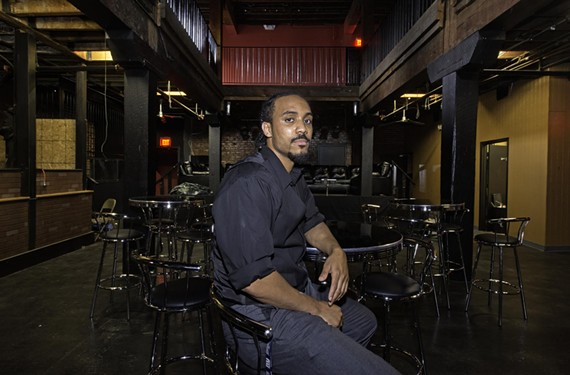 "Eric ""E.J."" Lewter Jr. sits in his new club, the Top, in the space at 10 Walnut Alley in Shockoe Bottom, which formerly held Alley Katz and Kingdom."