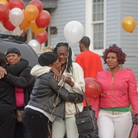 Scenes From the Vigil for Kiarri Edwards Family and friends gather to remember on Dinwiddie Avenue. The Richmond police closed a section of the street when dozens of people arrived. Scott Elmquist
