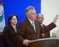 Flanked by Richmond Delegate Jennifer McClellan and Mayor Dwight Jones, Terry McAuliffe speaks to reporters at the Capitol in Richmond Wednesday.