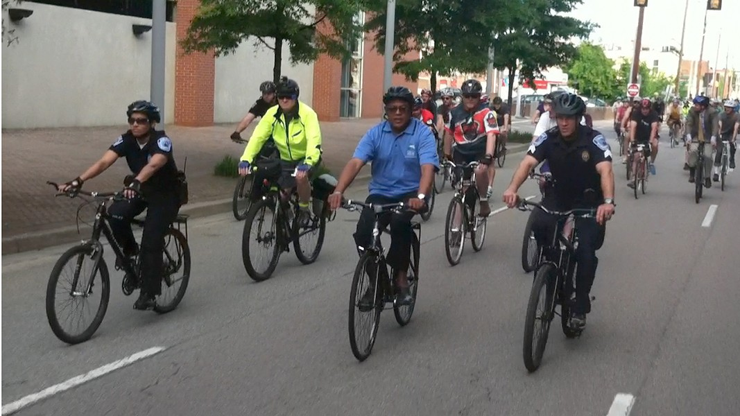 Flanked by two police officers, Richmond Mayor Dwight Jones leads cyclists on a ride to City Hall marking National Bike to Work Day. - NED OLIVER