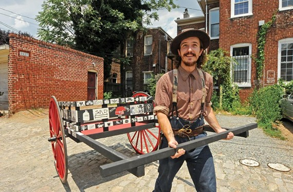Folk artist and tailor Charlie Umhau plans to leave VCU to spend a year pulling this cart around Richmond, hawking his handmade shirts. - SCOTT ELMQUIST