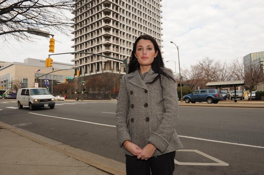 Former council aide Jennifer Walle says another legislative liaison, David Hathcock, harassed her a year ago.